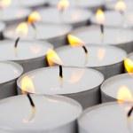 Group of burning round candles on white background — Stock Photo