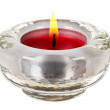 Round red candle in glass candlestick isolated on white backgrou — ストック写真