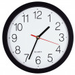 Simple classic black and white round wall clock isolated on whit — Stock Photo