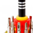 Close-up view of screw-driver with interchangeable bits kit isol — Stock Photo #23284432