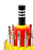 Close-up view of screw-driver with interchangeable bits kit isol — Stock Photo