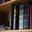 Bookshelf with photoalbums and books — Stock Photo #25179189