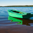 Stock Photo: Fishing boat anchorage near river bank