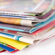 Pile of magazines on white — Stock Photo