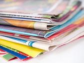 Pile of magazines on white — Stock Photo