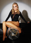 Glamour woman with disco-ball — Stock Photo