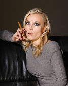 Beautiful woman with cigar — Stock Photo