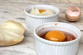 Egg in ramekin — Stock Photo