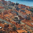 Royalty-Free Stock Photo: Panorama of Dubrovnik roofs in Croatia at sunrise, travel background