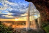 Seljalandfoss vattenfall vid solnedgången i hdr, island — Stockfoto