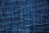 Blue wrinkled denim jeans texture, background — Stock Photo