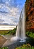 Seljalandfoss waterfall at sunset in HDR, Iceland — Stock Photo