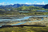 Wild river delta with mountains, Iceland — Foto de Stock