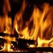 Fire in a fireplace, fire flames on a black background — Foto Stock