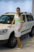 Hostess with Skoda Yeti on display at the 11th edition of International Autosalon Brno — Stock Photo