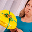 Young woman gets a thoughtless gift — Stock Photo