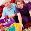 Female senior and pretty daughter become a lot of gifts — Stock Photo