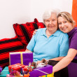 Mother and daughter with a lot of gifts — Stock Photo