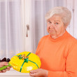 Female senior gets an dumb gift — Stock Photo