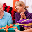 Stock Photo: Senior womand young female gets presents