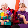 Stock Photo: Female senior with lot of gifts