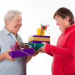 Senior and mental disabled womholding gifts — Foto de stock #34008547