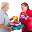 Stock Photo: Senior and mental disabled womholding presents