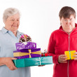 Foto Stock: Senior with lot of gifts, daughter only one