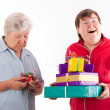 Stock Photo: Senior have only one gift, daughter with lot