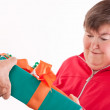 Disabled woman receives gift from senior — ストック写真