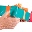 Stock Photo: Closeup, hands reaching each other gift