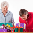 Senior with mentally handicapped daughter consider gifts — Stock Photo