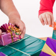 Stock Photo: Two women wrap or unpack gifts
