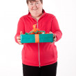 Stock Photo: Mentally disabled women gets or give gift