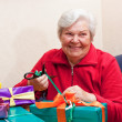 Female senior pack or unpack an gift — Stock Photo