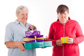 Senior with a lot of gifts, daughter only one — Stock Photo
