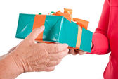 Closeup, hands reaching each other a gift — Stock Photo