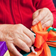 Senior citizen wrap or unpack gifts, closeup — Stock Photo