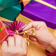 Senior citizen wrap or unpack presents, closeup — Stock Photo