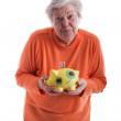 Senior holding a piggybank 2 — Stock Photo