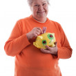 Friendly senior holding a piggybank — Stockfoto
