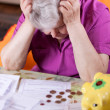 Elderly woman has need of money — Stock Photo