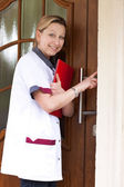 Nurse at the door for home visit — Stock Photo