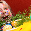 Blonde young woman with colorful Easter eggs — Stok fotoğraf