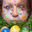 Woman with colorful points in the face — Stock Photo