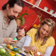 Couple painting Easter eggs together — Stock Photo