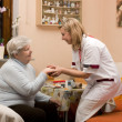 Home visit nurse with senior — Stock Photo