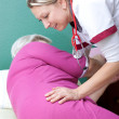 Nurse helps patient to get up — Stock Photo