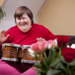 Mentally disabled woman plays drum — Stock Photo
