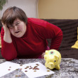 Disabled woman look desperate in front of her bills — Stock Photo